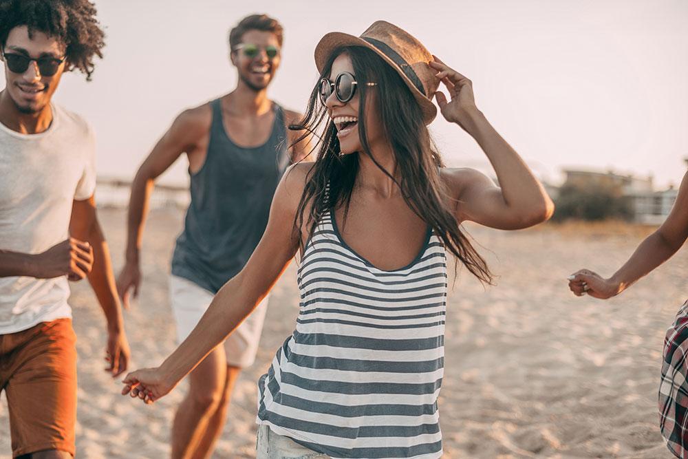 Young woman having fun on the beach
